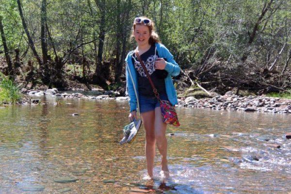 My daughter wading through Oak Creek
