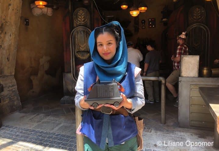 A cast member selling a popcorn holder