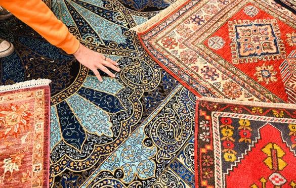 Detail of several rugs at Nakka's Cistern carpet showroom