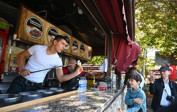 Food vendor creatively serving up ice cream in Sultanahmet Square