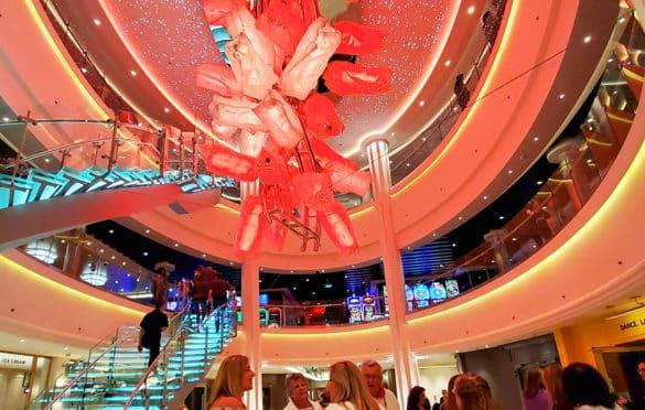The centerpiece sculpture in the atrium changes colors